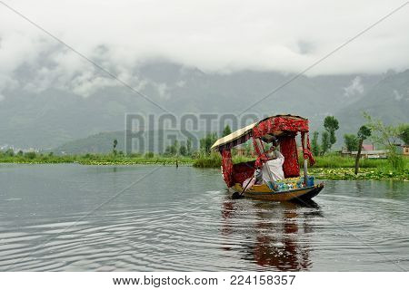 Local residents on the trip nice decorated 'Shikara', a small boat for transportation in the Dal lake of Srinagar