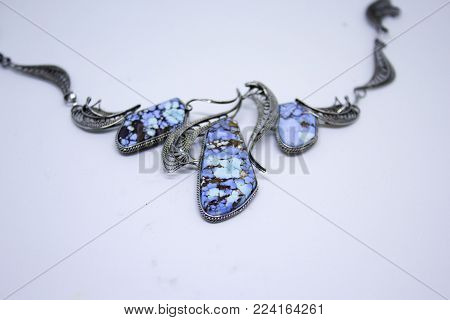 Original necklace with turquoise isolated on white background