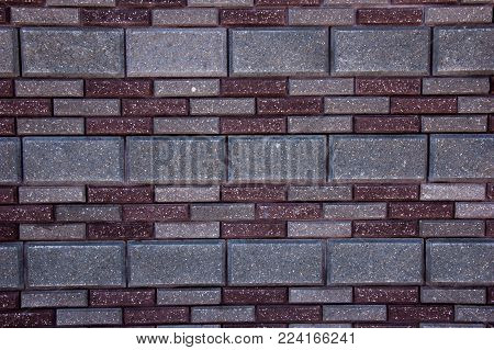 Abstract artistic background: wall of multicolored pavers.
