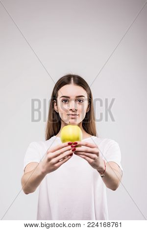Closeup Portrait Of Lovely Young Brunette Woman Biting Juicy Fresh Delicious Apple Against Gray Back