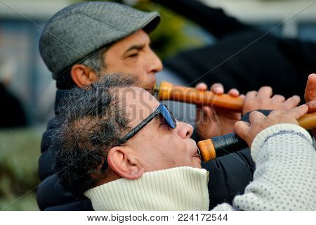 OHRID, MACEDONIA - JANUARY 19, 2017: Musicians playing zurna instrument during the celebration of Epiphany day in Ohrid, Macedonia,image