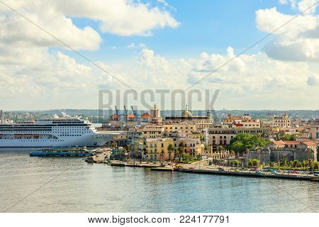 City panorama and big cruise ship docked in port of Havana, Cuba