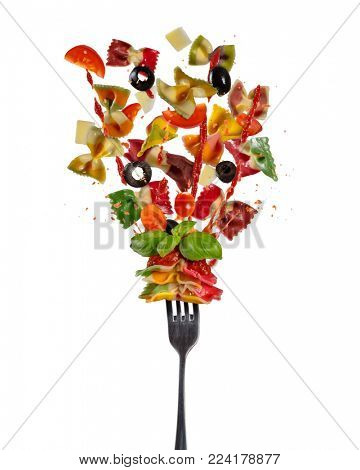 Concept of flying food with fork and traditional italian farfalle pasta with vegetable. Isolated on white background. Very high resolution image