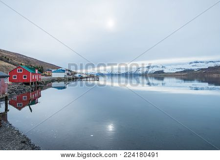 The reflection of the nature in Eskifjordur the small village of East fjord of East Iceland.