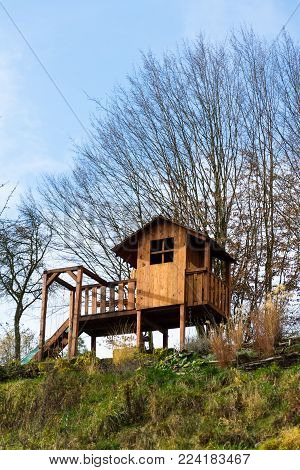 Diy Wooden Children Playhouse With Swing And Slide On Hillside