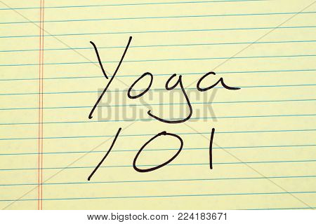 The words Yoga 101 on a yellow legal pad
