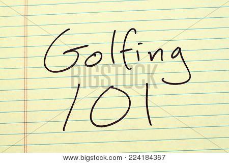 The words Golfing 101 on a yellow legal pad