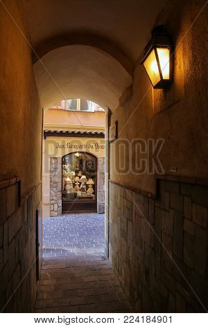 MONACO-VILLE, MONACO - JULY 11: Narrow alley leading to the street on July 11, 2015 in Monaco-Ville, Monaco. Monaco-Ville is one of the four traditional quarters of Monaco.