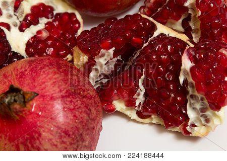 Purified Pomegranate Fruit On A White Background
