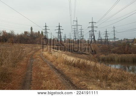 Coal Power Station In Beautiful Area Full Of Trees And Lake, Mirror Reflection Of Energetic Pole And