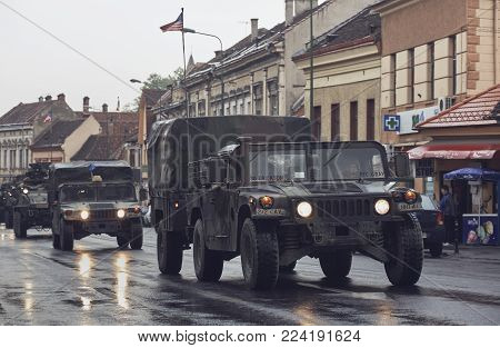 Brasov, Romania - May 14, 2015: American Convoy Of Troops And Wheeled Armored Vehicles Pass Through
