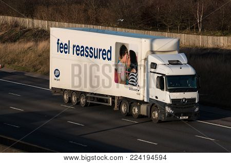 Redborn, UK - January 25, 2018: Lorry beloging Boots pharmacy chain in the United Kingdom, in motion on motorway M1