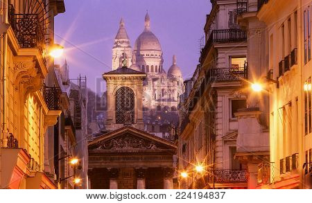The basilica Sacre Coeur and Notre Dame de Lorette church in the foreground, Paris, France.