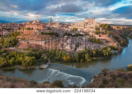 Aerial view of Old city of Toledo and river Tajo in the overcast day, Castilla La Mancha, Spain