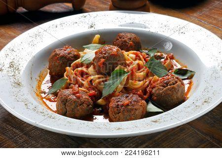Italian dish spaghetti bolognese with beef meatballs