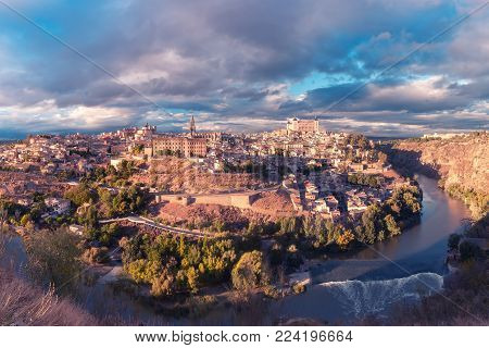 Panoramic aerial view of Old city of Toledo and river Tajo in the overcast day, Castilla La Mancha, Spain