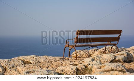 Beautiful wooden bench with seaview on the Cape Greco, Cyprus.
