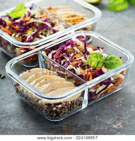 Healthy meal prep containers with quinoa, chicken and cole slaw