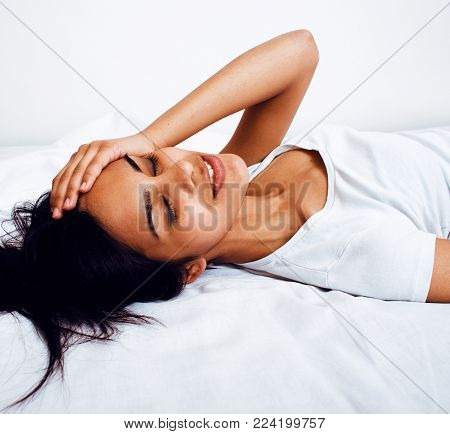 pretty brunette indian woman in bed, cant sleep, lifestyle real modern people close up