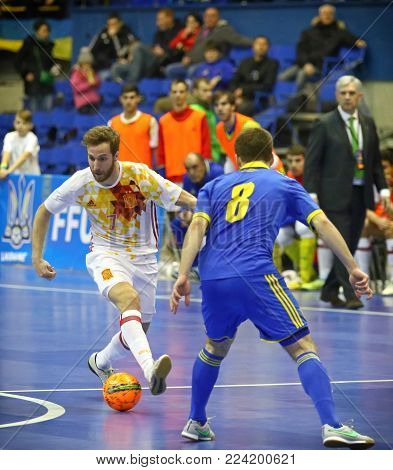 KYIV, UKRAINE - JANUARY 29, 2017: Pola of Spain (L) fights for a ball with Vitalii Dzuba of Ukraine during their Friendly Futsal match at Palats of Sports in Kyiv, Ukraine