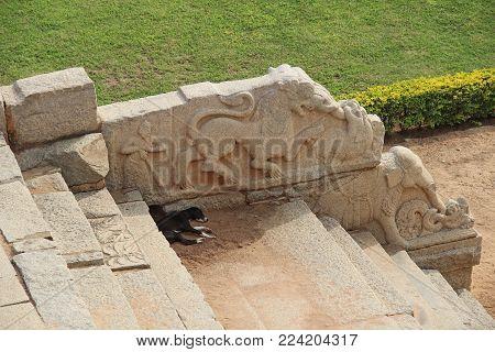 Mahanavami Dibba - The Great Platform UNESCO World heritage site in Hampi, Karnataka, India. Bas-reliefs and stepwell.