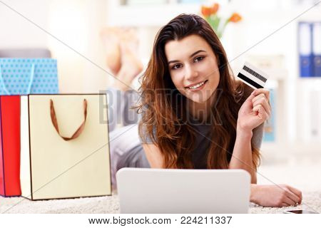 Picture showing pretty woman shopping online with credit card