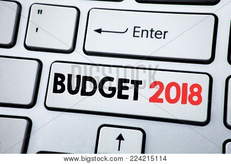 Writing text showing Budget 2018. Business concept for Household budgeting accounting planning written on white keyboard key with copy space. Top view