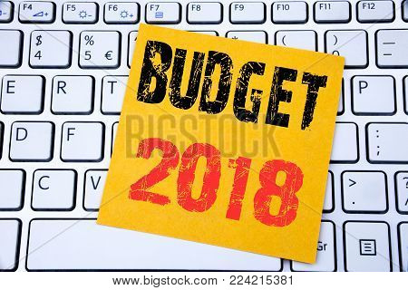 Budget 2018. Business concept for Household budgeting accounting planning written on sticky note paper on white keyboard background.