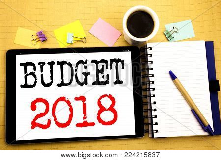 Budget 2018. Business concept for Household budgeting accounting planning Written on tablet, wooden background with sticky note and pen