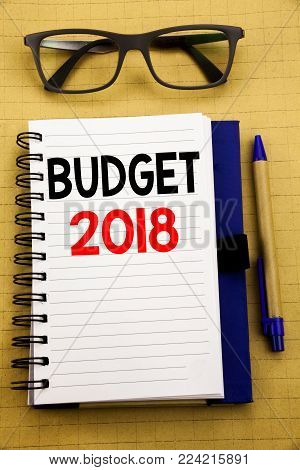 Handwriting Announcement text showing Budget 2018. Business concept for Household budgeting accounting planning Written on tablet, wooden background with sticky note and pen