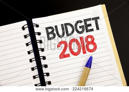 Handwriting Announcement text showing Budget 2018. Business concept for Household budgeting accounting planning written on notepad with space on old wood wooden background with pen marker