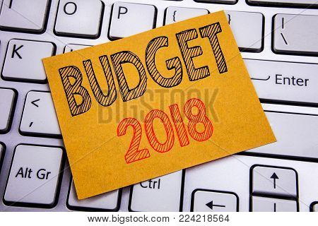 Conceptual hand writing text caption inspiration showing Budget 2018. Business concept for Household budgeting accounting planning written on sticky paper on the white keyboard background.
