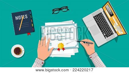 Businessman hand signs certificate. Diploma or accreditation with yellow stamp and red ribbons. Voucher or invitation. Graduation concept. Laptop, coffee, eyeflasses. Vector illustration in flat style