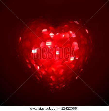 Red Blur heart shape of ligth bokeh on a black background.