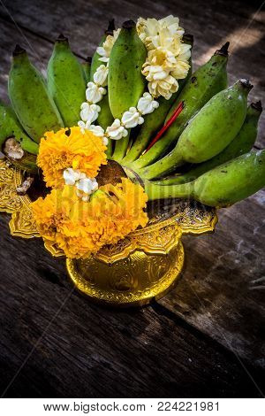 Banana And Flower Garland On Pedestal Tray