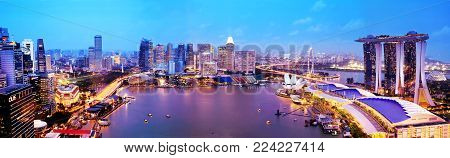 SINGAPORE - JANUARY 12, 2018: Panorama of Singapore city skyline at sunset, aerial view. Singapore business district with skyscrapers at twilight. Popular travel destination.