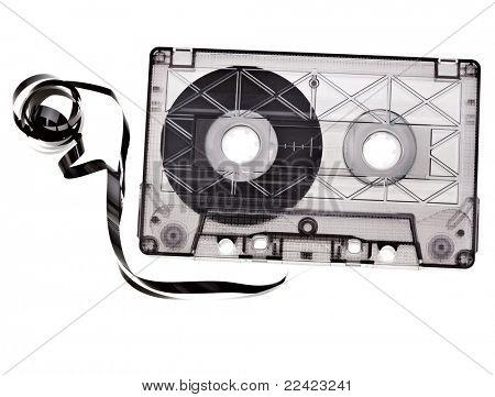 Old broken cassette isolated on white