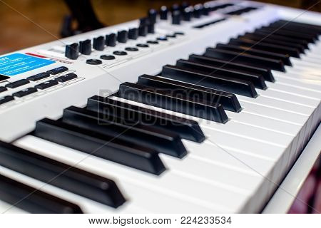 keys of a white musical synthesizer shot close-up