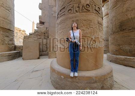 Woman looking on columns in Karnak Temple. Luxor, Egypt