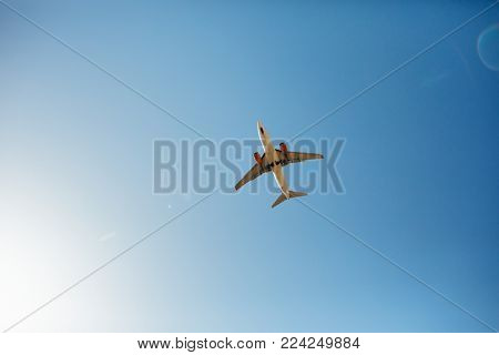 airplane in the sky, bottom view