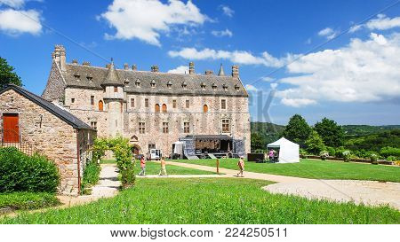 PLOEZAL, FRANCE - JULY 3, 2010: tourists in courtyard of medieval castle Chateau de la Roche-Jagu in Cotes-d'Armor department of Brittany in sunny summer day. The castle was built in 1418.