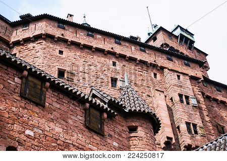 ORSCHWILLER, FRANCE - JULY 11, 2010: bottom viw of castle Chateau du Haut-Koenigsbourg in Alsace. First time the castle was mentioned in 1147, the building was restored and rebuilt in 1900-1908