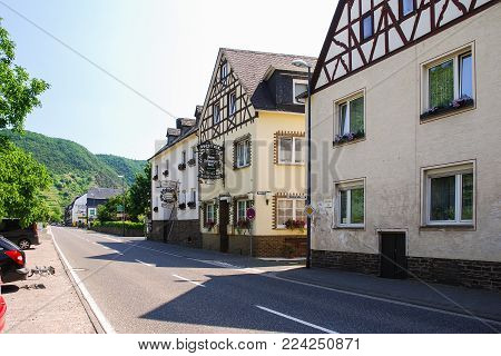 ZELL MOSEL, GERMANY - JUNE 28, 2010: vine restaurants and guest houses on Moselstrasse street along Moselle wine route in Mosel river valley in Cochem - Zell region in sunny summer day