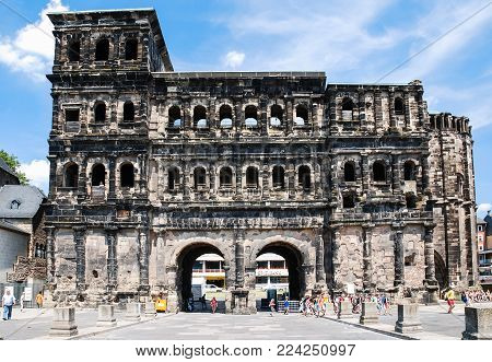 TRIER, GERMANY - JUNE 28, 2010: view of tourists near ancient roman monument
