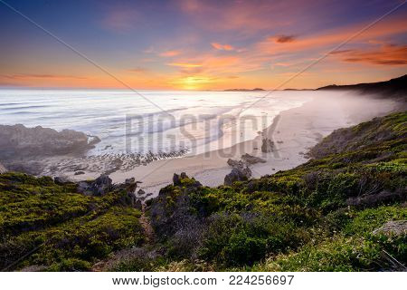 Long exposure of a colourful sunset over Brenton-on-sea main beach in South Africa