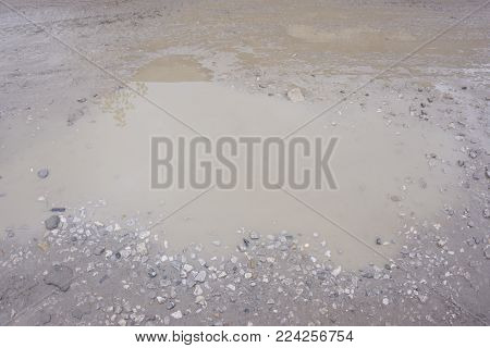 Close up of muddy puddle soil terrain water