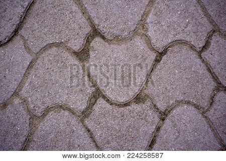 pink cement block on sidewalk, street paving slab, background and texture, fixed tessellated sidewalk tile