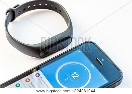 Russia, Voronezh - January 25, 2018: wristband Xiaomi Mi Band 2 and iPhone SE with open application Mi Fit ,fitness bracelet and sport tracker gadget with heart rate monitor and calorie counter