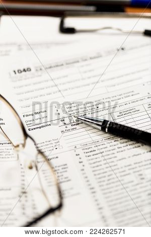 Closeup of US tax forms 1040. Useful as US taxs background