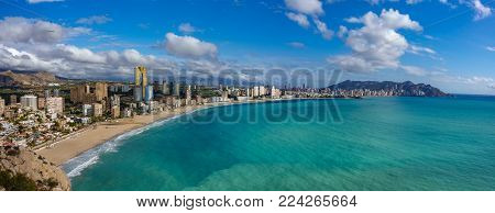 Wide breathtaking panoramic view Benidorm with high buildings, mountains and sea